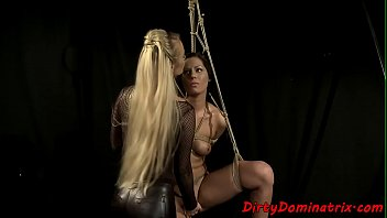 Lezdom babe dildoing restrained subs pussy