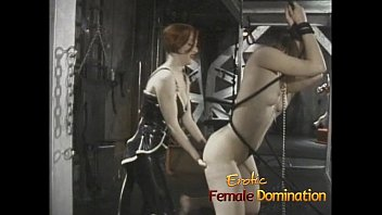 Naughty slut watches as two sexy babes have fun in the dungeon