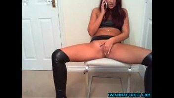 Sexy teen babe in latex masturbates while on the phone