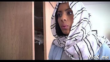 arab gal undresses inwards the library and begins stroking