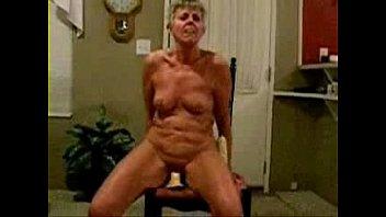 Fully nude granny riding a dildo